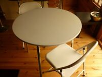 table and two fold up chairs