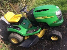 John Deere sit on lawn mower L105 automatic.