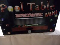 Table top pool and billiards table