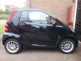 Convertible black Smart with red roof. 2 owners & full Mercedes serbice history. Beautiful car