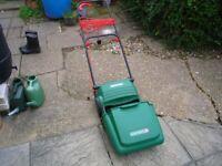 Qualcast electric lawn mower.