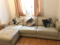 3 Seater, Cream Coloured Leather Sofa with Storage and Pull Out Bed