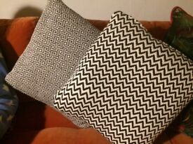 2 black and white cushions