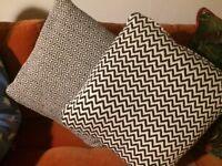 2 black and white cushions