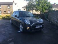 Black 5-door MINI Cooper with MINI Service Pack included