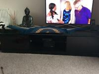 Gloss black TV stand with storage cupboards excellent condition £30. Ono
