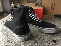 Size 9.5 black white high top vans