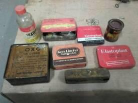 Vintage metal tins and glass bottle