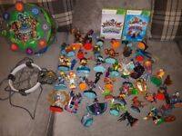 Xbox Skylanders Trap Team/Swap Force games with portal, apprx 50 figures/vehicles and a carry case