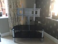 TV stand black glass with chrome legs, TV swivels for best viewing position in the room