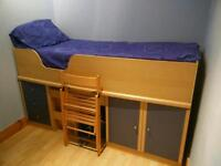Child's Cabin Bed with under storage , cupboard, drawers, fold up chair and ladder.