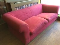 Big red couch needs new home