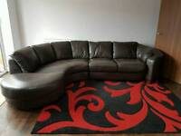 Brown leather Corner sofa and a single arm chair.
