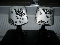 Two Black Table/ Deskside Lamps (Black Base) and Black and White Floral Design Shades.