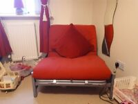 Red single futon bed