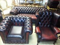3 piece ox blood leather chesterfield. large three setter club chair & high back chair.