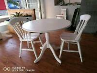Farmhouse round table and two chairs