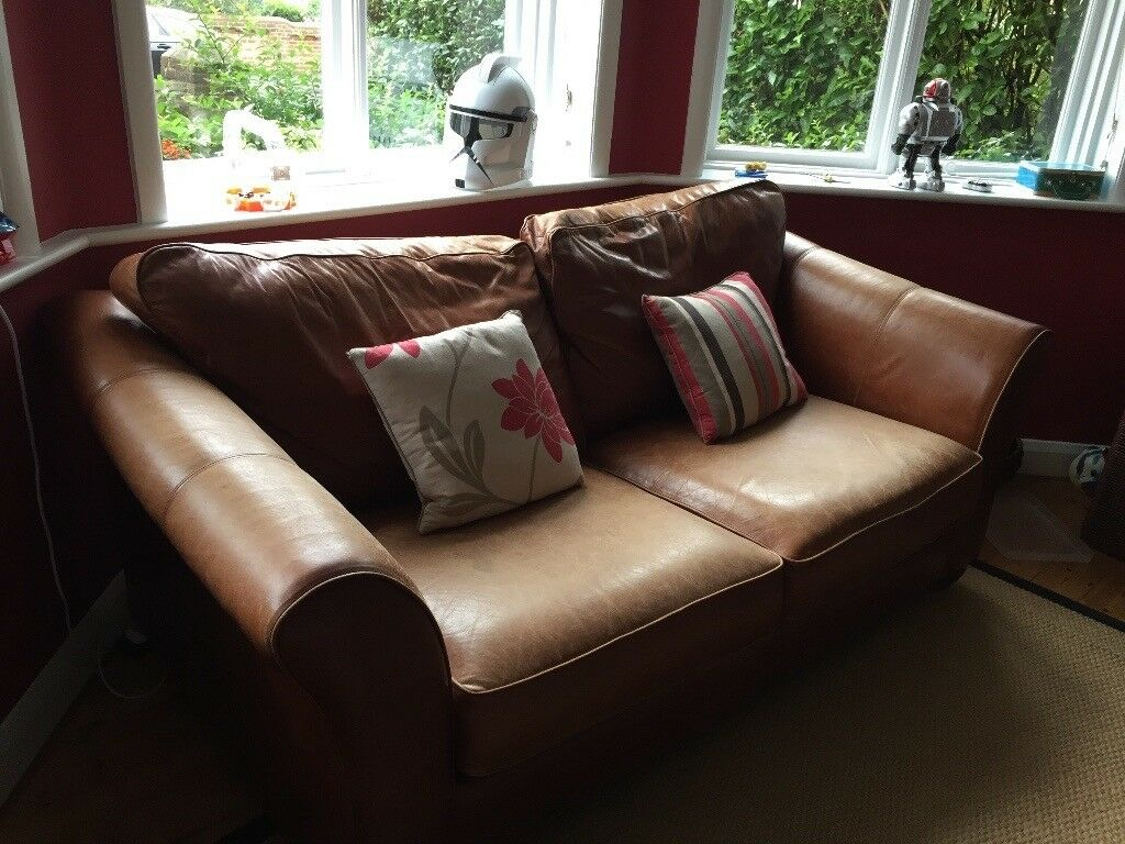 Aged leather sofa bed. Marks and Spencers brown leather sofa.