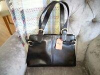 Gigi black leather handbag.