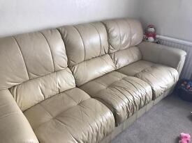 Two and three seater leather sofas.,