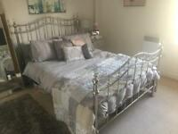 Chrome double bed with matress