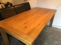 Beautiful solid oak extending table and 6 chairs