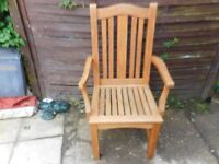 heavy wooden garden chair with arms