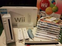 Nintendo Wii BUNDLE: Console + Wii Fit + 8 games + Nunchuck + accessory pack + more