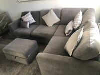 Grey corner sofa with foot storage less than year old DFS