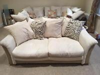 Cream 2 seater fabric sofa
