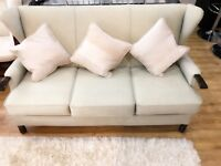 Three seater sofa and 4 cushions