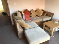 Corner sofa with foot rest and pull out double bed