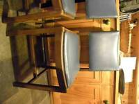 Set of four solid wood dining chairs