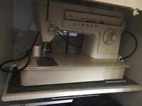 Singer sewing machine full working order with cabinet