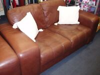 Brown leather two seater sofa with one chair