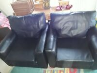 2 Black Leather Effect Armchairs. Hardly used. Fire safety tags. Colllection only from Christchurch.