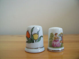 2 ceramic thimbles - period costume courting couple and 2 tulips (from Amsterdam?!). £1.50 for both