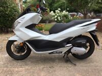 Excellent condition,absolute bargain,well below book price,Honda pcx 125 scooter!!