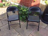 Folding black metal chairs