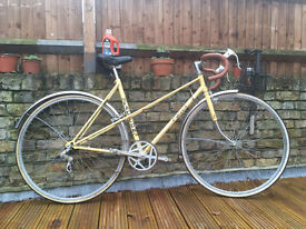 Cute old school yellow bike