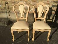 A pair of Italian Leather Chairs