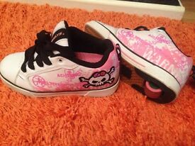 Heelys trainers x 2 pairs size 4. 1 boy and 1 girl