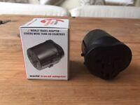 Universal travel mains plug adapter