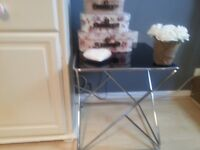 Designer side table bought in TKMAXX. Temper glass top and modern s/steel bottom.