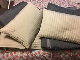 Two IKEA throws plus cushions fit double to super king size bed. One cream the other slate grey