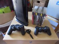 Sony Super Slim PS3 ~ 500 GB ~ 2 Controllers + 8 Games + Headset