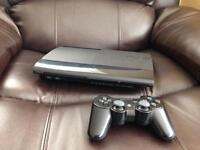 PS3 Super Slim 160GB + cables, games and controller.