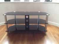 """Black smoked glass tv stand for sale, to suit tv's up to 42"""" wide. In excellent condition only £18"""