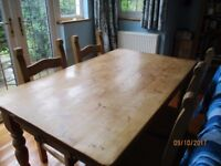 Pine table with 4 pine and wicker chairs
