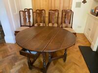 17th Oak gate-leg table and 8 high backed dining chairs